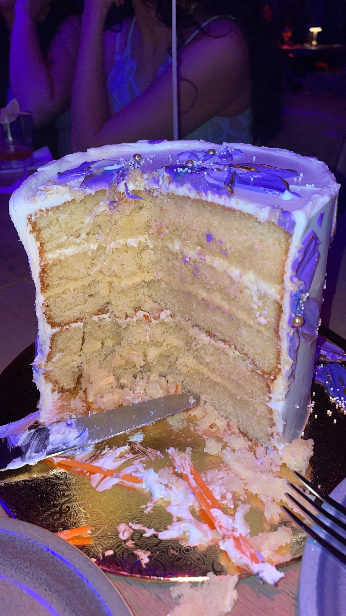 purple floral cake passionfruit and dulce de leche filling
