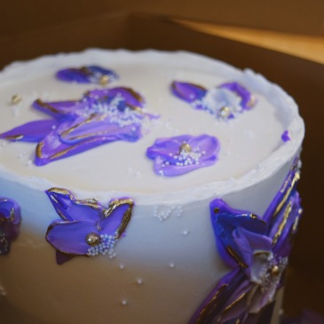 purple floral birthday cake with gold miami